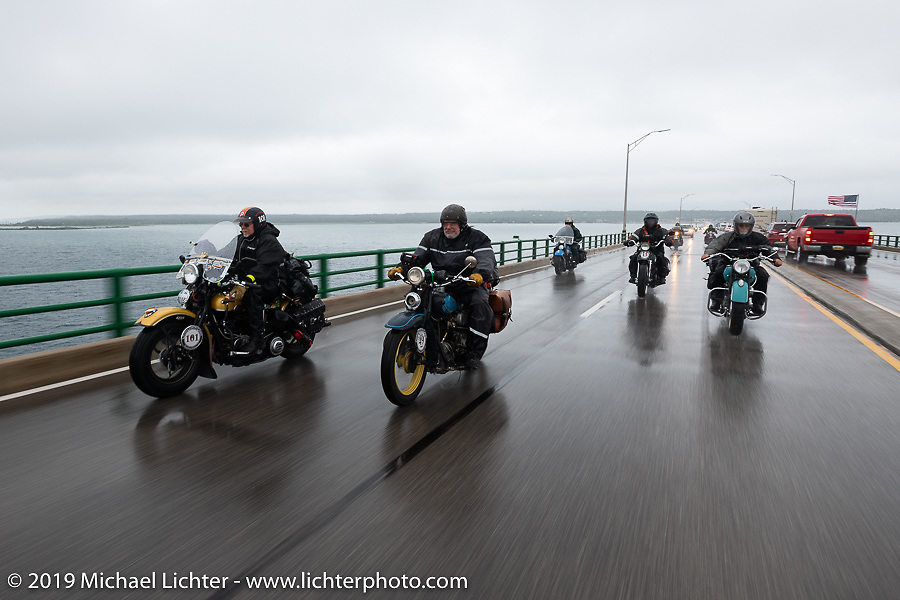 Crossing the Mackinac Bridge in the cold, rain and fog is Terry Richardson (L) on his 1946 Harley-Davidson FL Knucklehead beside Frank Westfall on his 1930 Henderson KJ in the on the Cross Country Chase motorcycle endurance run from Sault Sainte Marie, MI to Key West, FL. (for vintage bikes from 1930-1948). Stage 1 from Sault Sainte Marie to Ludington, MI USA. Friday, September 6, 2019. Photography ©2019 Michael Lichter.
