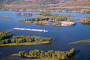 Sunrise aerial image over a barge on the MIssissippi River, Prairie du Chien, Crawford County, Wisconsin on a beautiful morning.