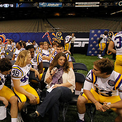 January 6, 2012; New Orleans, LA, USA; LSU Tigers players are interviewed by a reporter form ESPNU during Media Day for the 2012 BCS National Championship game to be played on January 9, 2012 against the Alabama Crimson Tide at the Mercedes-Benz Superdome.  Mandatory Credit: Derick E. Hingle-US PRESSWIRE
