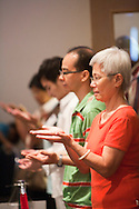 A shot of the congregation engaged in worship at the Evangelical Church of Bangkok (ECB) during the Easter service on 24 April 2011 in Bangkok, Thailand