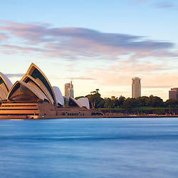 A shot from the North Shore  looking across to Sydney Opera House. The glow of the sunrise meets the stone of the opera house giving it a beautiful glow.