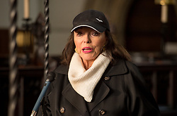 © Licensed to London News Pictures.  25/11/2017; Bristol, UK. Dame JOAN COLLINS speaking to women's group The Soroptomists in Bristol's Lord Mayor's Chapel at a rally against domestic violence and to campaign for healthy relationships. Under the banner 'Railing Against Abuse', members of the group travelled to Bristol by train on Saturday, November 25, before walking to College Green where they handed out leaflets entitled Loves Me, Loves Me Not in the shape of bookmarks and cards which offer a simple message about abusive relationships and a helpline for anyone who needs support. They were joined at College Green by Dame Joan Collins and her daughter Tara Newley Arkle, Lord Mayor Lesley Alexander, and Avon & Somerset Police and Crime Commissioner Sue Mountstevens. The march marks the United Nations' Elimination of Violence Against Women Day. Picture credit: Simon Chapman/LNP