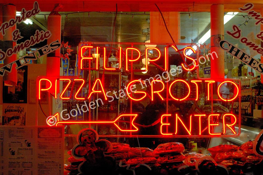 Landmark Italian restaurant Filippis, famous for their pizza and chianti bottles hanging from the ceiling.