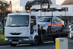 © London News Pictures. 19/11/2011. A police car which was involved the pursuit of a man who later stabbed four police officers on Kingsbury Road, North West London being removed. A man attacked the police officers with a knife he grabbed from a local butchers shop after he had been chased by the police. Photo credit : Ben Cawthra/LNP