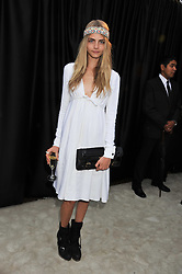 CARA DELEVINGNE at the annual Serpentine Gallery Summer Party sponsored by Burberry held at the Serpentine Gallery, Kensington Gardens, London on 28th June 2011.
