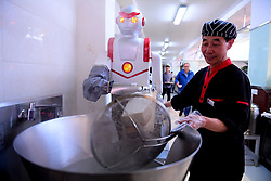 SHENYANG, CHINA - MAY 09: ..Robots Shave Noodles At  School Canteen ..A robot slices noodles for students at Shenyang Agricultural University on May 9, 2017 in Shenyang, Liaoning Province of China. Sliced noodles made by the two robots serve in the school canteen of Shenyang Agricultural University. .©Exclusivepix Media (Credit Image: © Exclusivepix media via ZUMA Press)