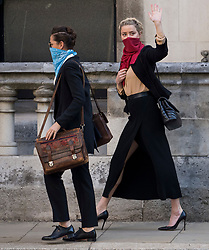 © Licensed to London News Pictures. 22/07/2020. London, UK. American actress AMBER HEARD (right) arrives at the High Court in London with her partner BIANCA BUTTI (left), where Johnny Depp is in a legal dispute with UK tabloid newspaper The Sun over allegations he assaulted his former wife, Amber Heard. Photo credit: Ben Cawthra/LNP
