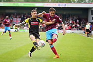 Scunthorpe United's Josh Morris (11) and Rotherham United midfielder Jon Taylor (11) during the EFL Sky Bet League 1 match between Scunthorpe United and Rotherham United at Glanford Park, Scunthorpe, England on 12 May 2018. Picture by Nigel Cole.