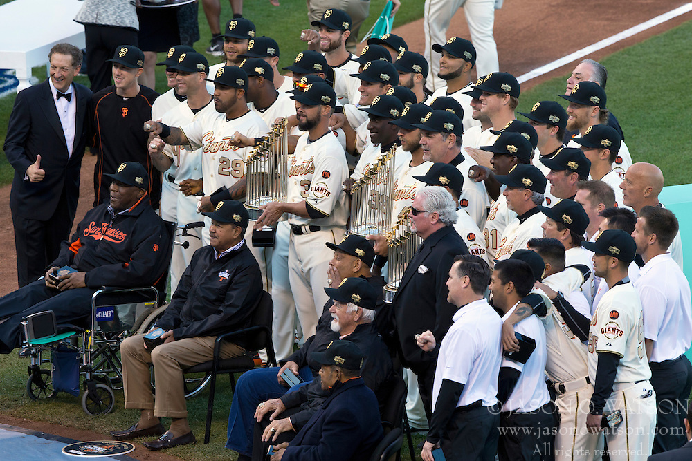 SAN FRANCISCO, CA - APRIL 18:  The San Francisco Giants stand on the field during the 2014 World Series ring ceremony before the game against the Arizona Diamondbacks at AT&T Park on April 18, 2015 in San Francisco, California.  The San Francisco Giants defeated the Arizona Diamondbacks 4-1. (Photo by Jason O. Watson/Getty Images) *** Local Caption ***