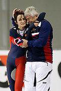 Martina Sablikova of the Czech Republic, left, celebrates her world record breaking run with her coach Peter Novak, right, after the women's 5000 meter World Cup speed skating event at the Utah Olympic Oval in Kearns, Utah, Friday, Feb. 18, 2011. Sablikova's finished with the time of 6:42.66. (AP Photo/Colin E Braley)