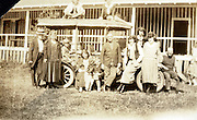 family posing by station mini bus styled car 1920s USA