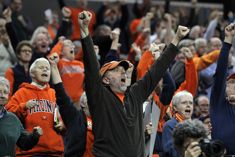 Virginia fans celebrate the 86-72 win over #6 ranked Maryland Thursday in Charlottesville, VA. Photo/The Daily Progress/Andrew Shurtleff