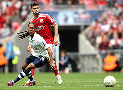 Swindon Town's Yaser Kasim passes the ball past Preston North End's Daniel Johnson - Photo mandatory by-line: Robbie Stephenson/JMP - Mobile: 07966 386802 - 24/05/2015 - SPORT - Football - London - Wembley Stadium - Preston North End v Swindon Town - League One Playoff Final