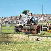 A panoramic image showing the Australian Eventing team of Phillip Dutton on House Doctor, Andrew Hoy on Darien Powers, Stuart Tinney  on Jeepster and Matt Ryan on Kibah Sandstone in action during their Gold Medal win during the Equestrian competition at the Sydney Equestrian Centre during the  2000 Sydney Olympic Games...Panoramic images from the Sydney Olympic Games, Sydney, Australia.  2000 . Photo Tim Clayton