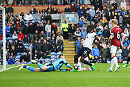 Burnley Goalkeeper Thomas Heaton saves at the feet of Moussa Sissoko of Tottenham Hotspur. Premier League match, Burnley v Tottenham Hotspur at Turf Moor in Burnley , Lancs on Saturday 1st April 2017.<br /> pic by Chris Stading, Andrew Orchard sports photography.