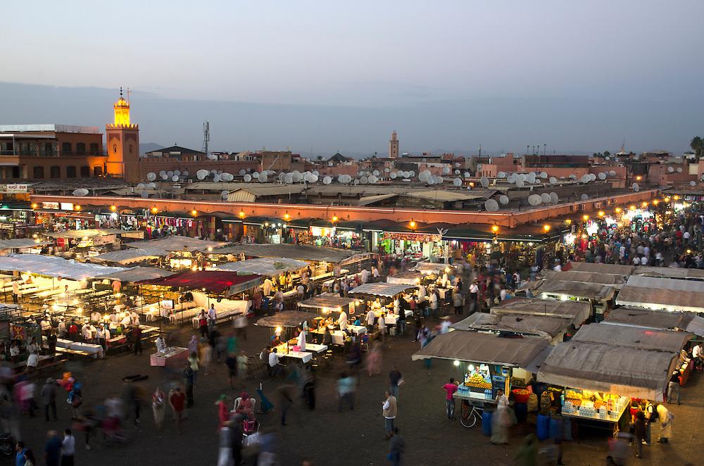 Bustling Jemaa El Fna square at dusk Marrakech Morocco