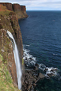 A view of the waterfall and basalt columnar cliffs at Kilt Rock, on the Trotternish Peninsula in the Isle of Skye, Scotland