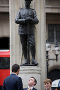 Young men of today and a lost generation of youth. In the 100th year after WW1 started, the war memorial heroes in Cornhill, City of London remembering those killed in the First World War, lost in the trenches and the fields of Flanders from 1914-19. Dedicated by the City of London, the UK capital's financial and historic heart. Two soldiers face away from each other with rifles between their boots, they represent a lost generation when the nation's youth sacrificed their lives in the 20th century's first great conflict. The inscription says that their names will live for evermore.