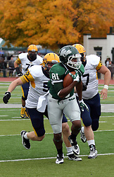 18 October 2014:  Thomas Enke(DE) and Sean McIntyre (DE)  continue to chase Quincy Butler during an NCAA division 3 football game between the Augustana Vikings and the Illinois Wesleyan Titans in Tucci Stadium on Wilder Field, Bloomington IL