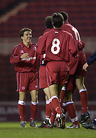 Photo. Jed Wee<br />Middlesbrough v Bradford Reserves, The Riverside, Middlesbrough. 25/02/2003.<br />Middlesbrough's Juninho joins the celebrations on his return from injury.