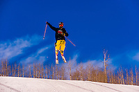 Skier jumping, Snowmass Terrain Park, Snowmass/Aspen ski resort, Snowmass Village, Colorado USA.