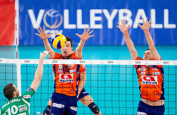 Dore Della Lunga of Cuneo vs Milan Rasic of ACH and Andrej Flajs of ACH during volleyball match between ACH Volley Ljubljana and Bre Banca Lannutti Cuneo (ITA) in Playoff 12 game of CEV Champions League 2012/13 on January 15, 2013 in Arena Stozice, Ljubljana, Slovenia. (Photo By Vid Ponikvar / Sportida.com)