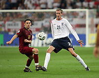 Photo: Chris Ratcliffe.<br /> England v Portugal. Quarter Finals, FIFA World Cup 2006. 01/07/2006.<br /> Peter Crouch of England clashes with Maniche of Portugal.