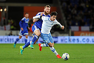Sheffield Wednesday's Kieran Lee (r) is challenged by Cardiff City's Aron Gunnarsson. EFL Skybet championship match, Cardiff city v Sheffield Wednesday at the Cardiff city stadium in Cardiff, South Wales on Wednesday 19th October 2016.<br /> pic by Carl Robertson, Andrew Orchard sports photography.