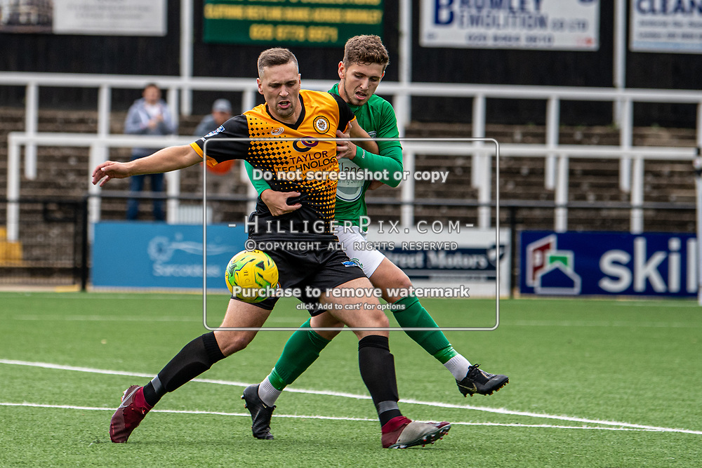 BROMLEY, UK - SEPTEMBER 22: Joseph Taylor, of Cray Wanderers FC, holds off the defender during the Emirates FA Cup Second Round Qualifier match between Cray Wanderers and Soham Town Rangers at Hayes Lane on September 22, 2019 in Bromley, UK. <br /> (Photo: Jon Hilliger)