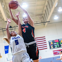 Miyamura Patriot Autumn Enote (5) loses out on a rebound to Gallup Bengal Journey Gillson (4) at Miyamura High School Thursday.