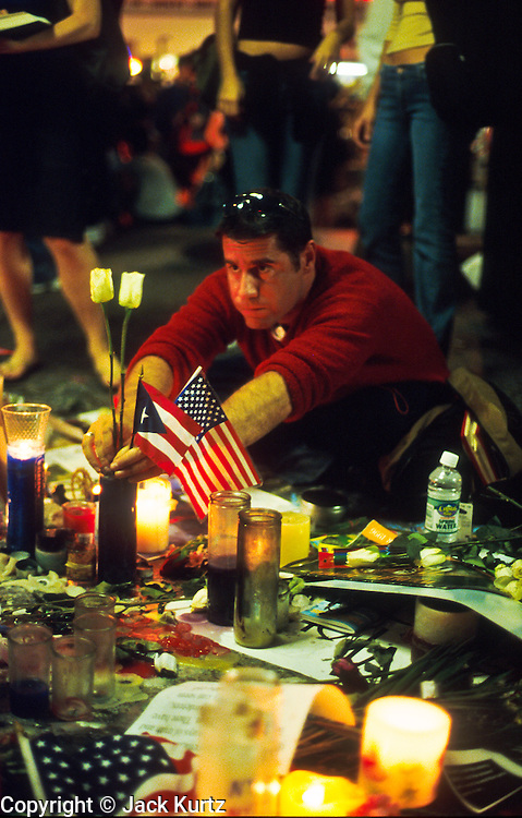 18 SEPTEMBER 2011 - NEW YORK, NY: A man creates a memorial for his girlfriend in Union Square in New York City, Sept 18, 2001. He said she was  killed in the terrosist attack on the World Trade Center, Sept. 11, 2001. More than 2,900 people were killed when terrorists, thought to be affiliated with Osama bin Laden, hijacked and crashed two passenger jets into the twin towers on the southern tip of Manhattan.  PHOTO BY JACK KURTZ