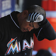 NEW YORK, NEW YORK - APRIL 13: Ichiro Suzuki, Miami Marlins, preparing to bat in the dugout during the Miami Marlins Vs New York Mets MLB regular season ball game at Citi Field on April 13, 2016 in New York City. (Photo by Tim Clayton/Corbis via Getty Images)