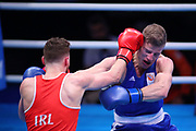 Max Van Der Pas of The Netherlands (bue) and Michael Nevin of Ireland (red) competing in the Men's Middleweight preliminaries during The Road to Tokyo European Olympic Boxing Qualification, Sunday, March 15, 2020, in London, United Kingdom. (Mitchell Gunn-ESPA-Images/Image of Sport)