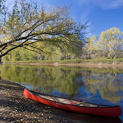A canoe rests on the banks of he Connecticut River in Maidstone, Vermont.