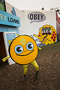 "Pocket Money Loans for kids, Shangri La field, Glastonbury Festival 2016. The shop is an exhibition designed to draw attention to the way the consumer credit industry preys on the vulnerable and targets children with marketing.<br /> The project's aim, artist Darren Cullen says, is to ""take our consumer debt culture to its logical conclusion.""<br /> The Glastonbury Festival is the largest greenfield festival in the world, and is now attended by around 175,000 people. Its a five-day music festival that takes place near Pilton, Somerset, United Kingdom. In addition to contemporary music, the festival hosts dance, comedy, theatre, circus, cabaret, and other arts. Held at Worthy Farm in Pilton, leading pop and rock artists have headlined, alongside thousands of others appearing on smaller stages and performance areas."