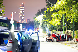 © Licensed to London News Pictures. 21/09/2021. Salford, UK. Firefighters, paramedics and police attend the scene following a road traffic accident, appearing to involve two cars, on Churchill Way in Salford . Photo credit: Joel Goodman/LNP