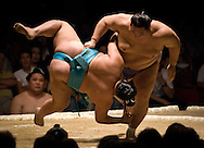 Kaio (right) throws down Toyonoshima  in the second round of Day 1 of Grand Sumo Tournament Los Angeles 2008, Los Angeles Sports Arena, Los Angeles, California