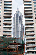 The Jin Mao Building looms up behind construction of new high rise apartment buildings in Pudong, Shanghai, China.