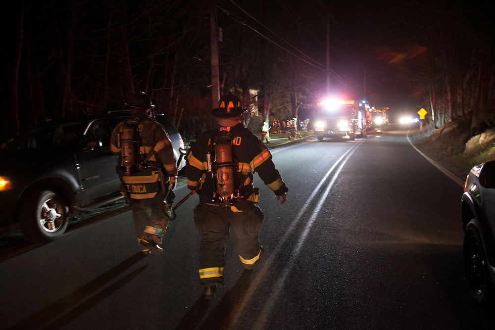 Sherborn, MA 04/11/2013<br /> Firefighters from Ashland arrive at a 3 alarm house fire at 255 Western Ave. in Sherborn on Thursday night.<br /> Alex Jones / www.alexjonesphoto.com