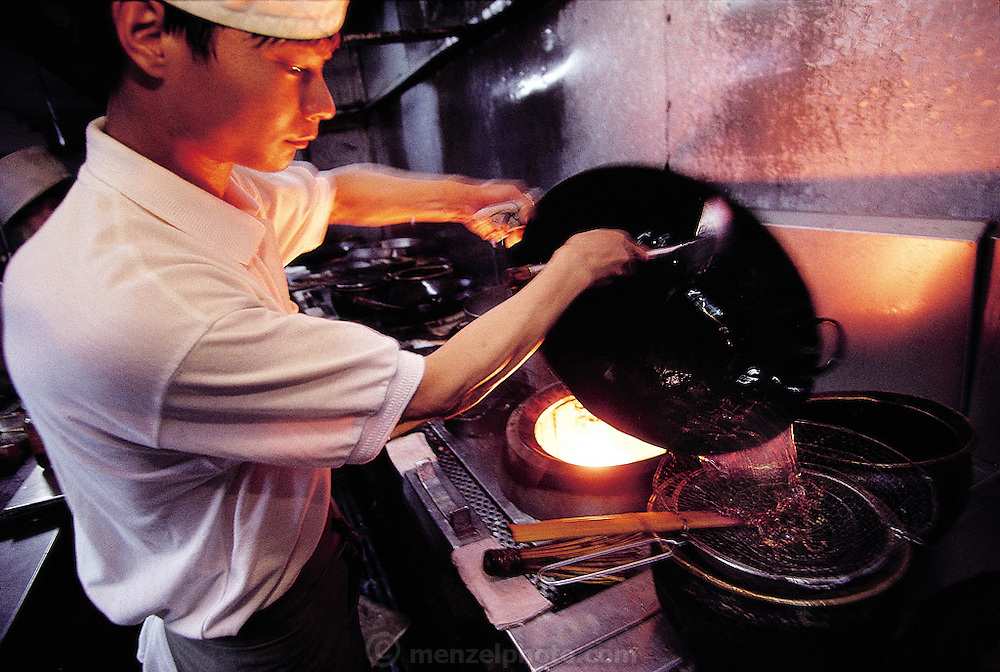 "One of the chefs of the ""Elegant Good Smell Restaurant"" prepares scorpion soup and stir-fried scorpions in woks, Louyang, China.(Man Eating Bugs page 98)"