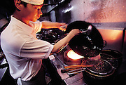 """One of the chefs of the """"Elegant Good Smell Restaurant"""" prepares scorpion soup and stir-fried scorpions in woks, Louyang, China.(Man Eating Bugs page 98)"""