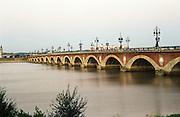 The famous pont de pierre bridge that crosses the garonne river in Bordeaux to the Old Town , Bordeaux, Aquitaine, France