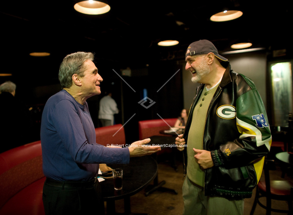 Promoter Milan Simich, left, and brother of current US poet laureate Charles Simic (last names spelled differently) shares a moment with former laureate, Robert Pinsky prior to a poetry reading during to a collaboration with jazz musicians and former laureate, Robert Pinsky, at the Jazz Standard in New York, U.S. 1/8/08.