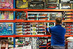 © Licensed to London News Pictures. 13/10/2021. London, UK. A man picks up a toy in a toy shop in north London. Retailers are warning of toy shortages in the lead up to Christmas, amid fears of ongoing supply chain problems will result in higher prices and empty shelves. Photo credit: Dinendra Haria/LNP