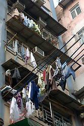 Laundry hanging to dry outside old tenement building in Kowloon Hong Kong