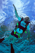 Colombo, Sri Lanka. Sir Arthur C. Clarke donned scuba gear for this photograph for the first time since 1991 and dives in the pool at the Otter Swim Club. Clarke moved to Sri Lanka in part for the excellent scuba diving more than 40 years ago. He is too frail to dive in the ocean. Published in Stern Magazine, 28 December 2000 issue, page 76. (He has post-polio syndrome) Best known for the book 2001: A Space Odyssey. MODEL RELEASED