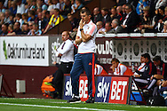 Brentford Manager Marinus Dijkhuizen looks on deep in thought. Skybet football league championship match, Burnley  v Brentford at Turf Moor in Burnley, Lancs on Saturday 22nd August 2015.<br /> pic by Chris Stading, Andrew Orchard sports photography.