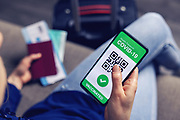 vaccinated person using digital health passport app in mobile phone for travel during covid-19 pandemic. green certificate