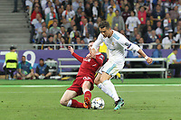 KIEV, UKRAINE - MAY 26: Andy Robertson of Liverpool competes with Cristiano Ronaldo of Real Madrid during the UEFA Champions League final between Real Madrid and Liverpool at NSC Olimpiyskiy Stadium on May 26, 2018 in Kiev, Ukraine. (MB Media)
