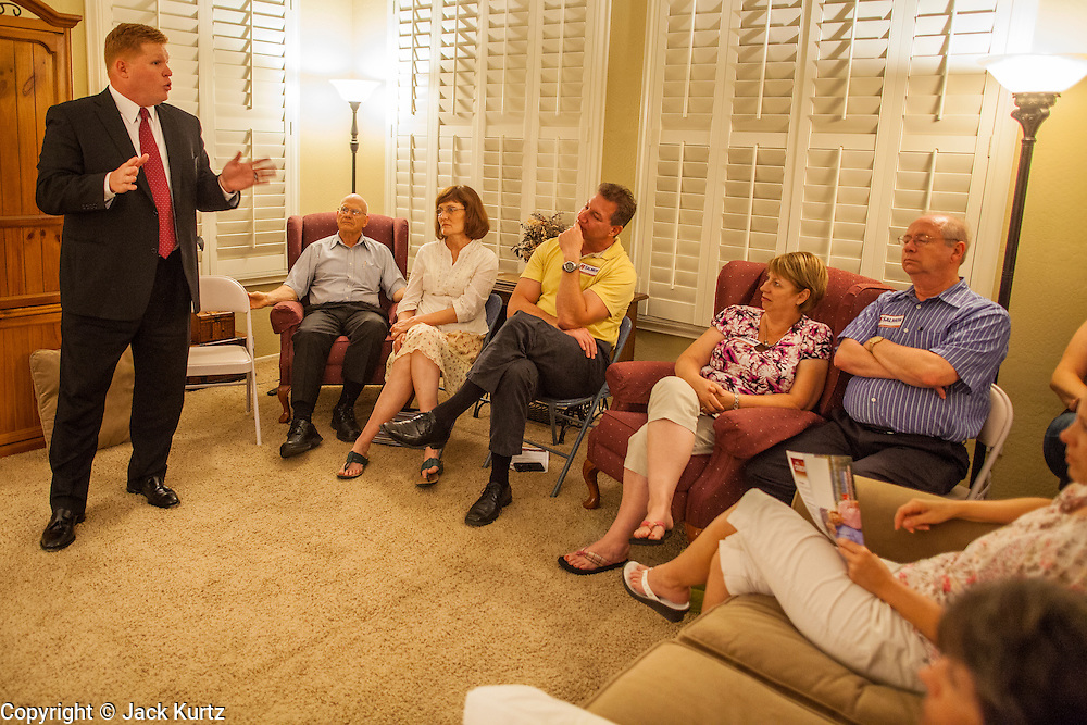 """03 AUGUST 2012 - GILBERT, AZ:  WIL CARDON campaigns with Republican voters during a """"meet & greet"""" in a private home in Gilbert, AZ, Friday. Cardon, a wealthy businessman, is running in the Republican primary for the US Senate seat being vacated by Sen. Jon Kyl. He is running against long serving Congressman Jeff Flake, who currently represents Arizona's 6th Congressional District, a conservative, largely Mormon, district in the suburbs of Phoenix. Both Cardon and Flake are active Mormons and both men are running as """"Tea Party"""" inspired conservatives. Whoever wins the August 28 primary will face Dr. Richard Carmona in November's general election.  PHOTO BY JACK KURTZ"""